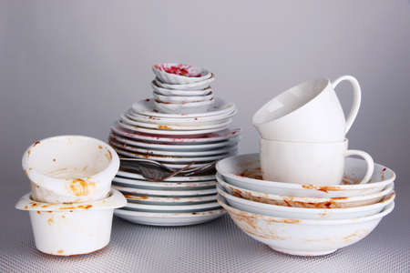 dirty: Dirty dishes on gray background Stock Photo