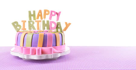 Delicious birthday cake on table on white background
