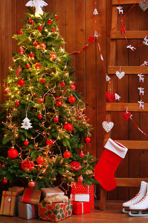 decorated christmas tree and ladder on wooden wall background stock photo 36625932