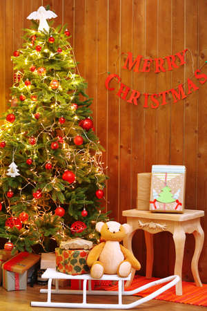 Decorated Christmas living room  on wooden wall background photo