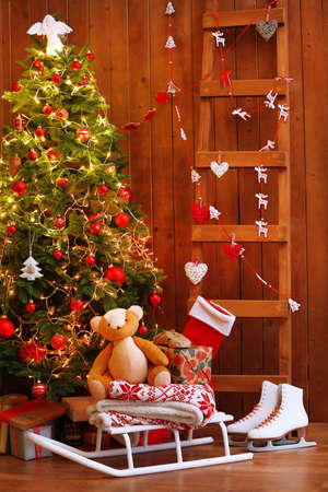 decorated christmas tree ladder and sledge on wooden wall background stock photo 36625663