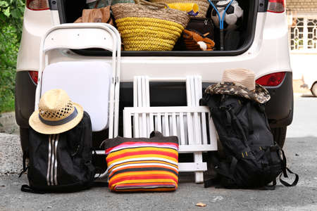 to depart: Suitcases and bags in trunk of car ready to depart for holidays