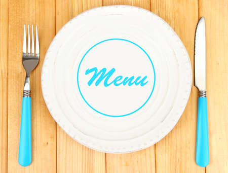 place to shine: Plate with text Menu, fork and knife on wooden background Stock Photo