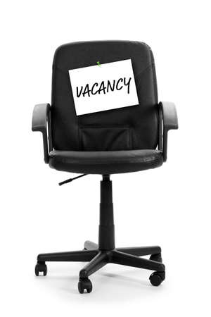 vacant sign: Black office chair with vacancy sign isolated on white