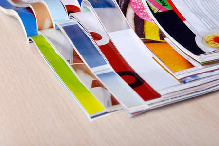 Magazines on wooden table close up photo