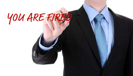 you are fired: Businessman writing You are fired on screen isolated on white