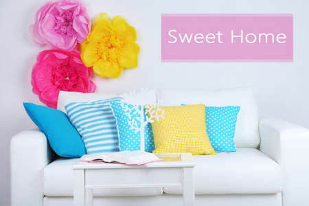 idea comfortable: White sofa with colorful pillows in room on wall background, Sweet Home concept