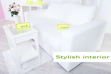 New white furniture with prices in showroom photo