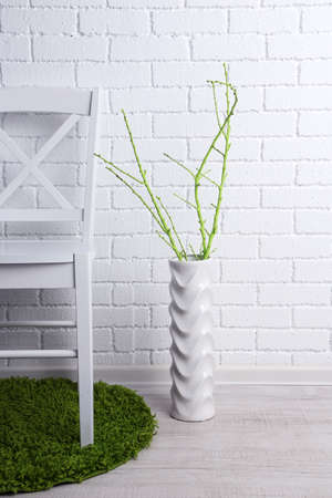ideally: Modern interior with chair on white brick wall background Stock Photo