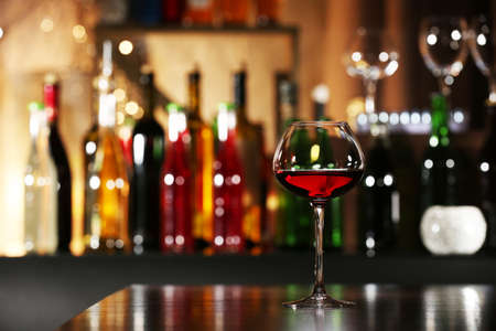 wine bar: Glass of wine with bar on background
