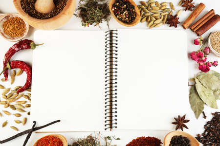 recipe book: Spices with recipe book on white background Stock Photo