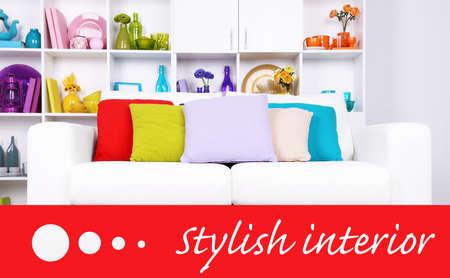 Modern interior design. White living room with sofa and bookcase. Stylish interior concept photo