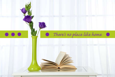 Beautiful flowers in vase on window background and space for your text photo