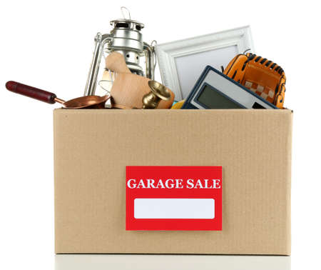 baseball stuff: Box of unwanted stuff ready for a garage sale, isolated on white