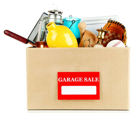 garage sale: Box of unwanted stuff ready for a garage sale, isolated on white