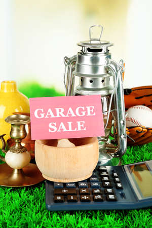 baseball stuff: Unwanted things ready for a garage sale, on green grass