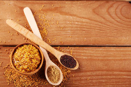 kinds: Composition of different kinds of mustard on wooden background