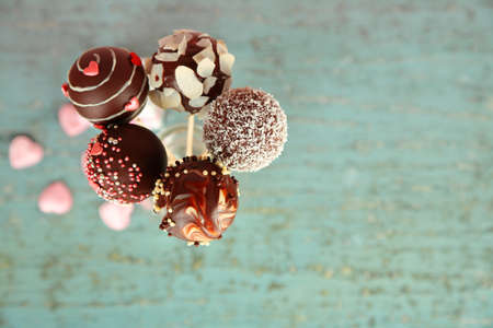 childrens food: Tasty cake pops on wooden background Stock Photo