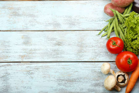 Summer frame with fresh organic vegetables and fruits on wooden background