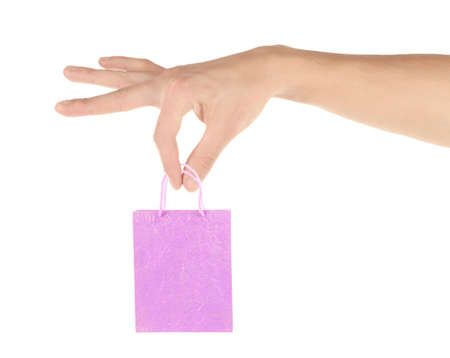 small paper: Small paper bag in big hand isolated on white Stock Photo