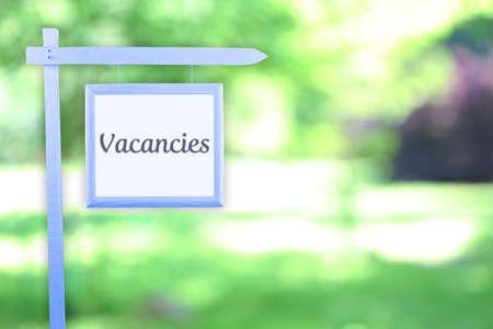vacancies: Signboard with text Vacancies near hotel
