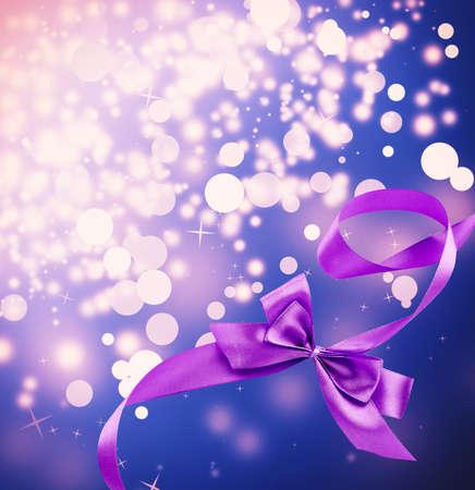 Satin ribbon bow on bright background photo
