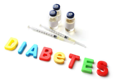 diabetes syringe: Injections and word Diabetes from colorful letters isolated on white Stock Photo