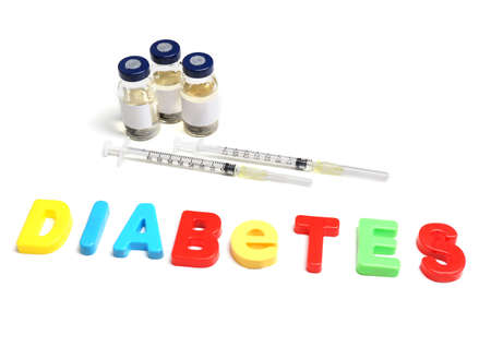 Injections and word Diabetes from colorful letters isolated on white photo