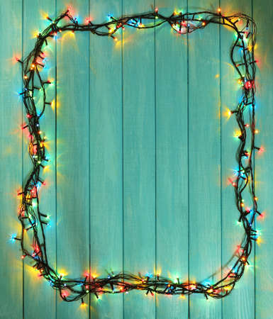 conviviality: Colorful Christmas lights on wooden planks background
