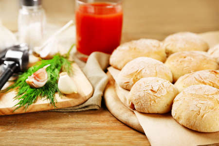 Fresh homemade bread buns from yeast dough with fresh garlic and dill, on wooden background photo