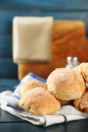 ferment: Fresh homemade bread buns from yeast dough with fresh garlic and dill, on wooden background Stock Photo