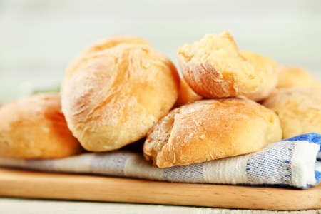 ferment: Fresh homemade bread buns from yeast dough on wooden board, on wooden