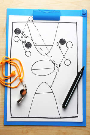 board marker: Scheme basketball game on clip board paper with marker and wooden table  Stock Photo