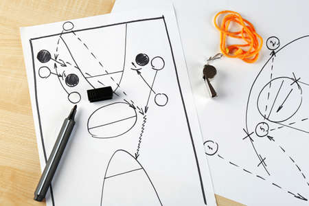 instruction sheet: Scheme basketball game on sheet of paper and wooden table background Stock Photo