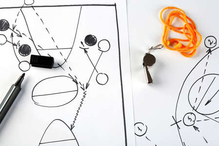 Scheme basketball game on sheet of paper background photo
