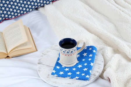 bedsheets: Book and cup of tea on bed close-up
