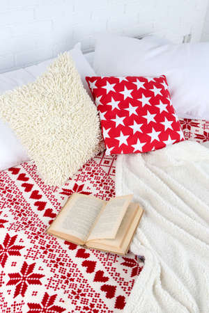 bedsheets: Book on bed close-up