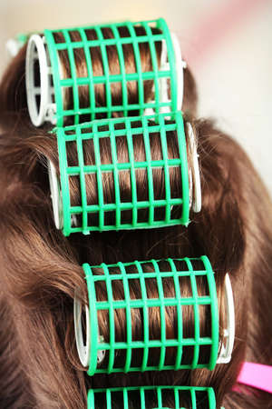 curler: Long female hair during hair dressing with curler, close-up Stock Photo