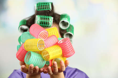 hair curlers: Girl in hair curlers on bright background