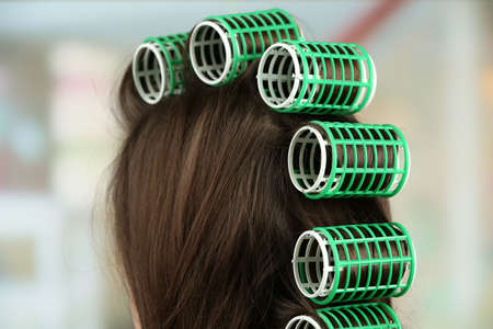 hair curler: Long female hair during hair dressing with curler, close-up Stock Photo
