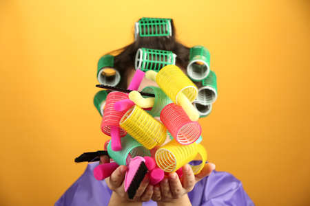 hair curlers: Girl in hair curlers on colorful background