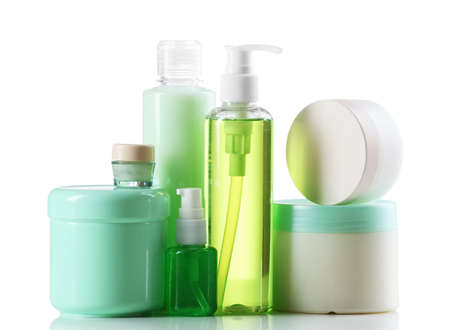Cosmetic bottles on white background