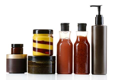 Cosmetic bottles on light background