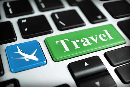 Travel concept. Keyboard of modern laptop close up photo