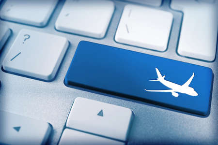 keyboard button: Travel concept. Keyboard of modern laptop close up Stock Photo