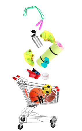 strong base: Sport goods falling into cart isolated on white