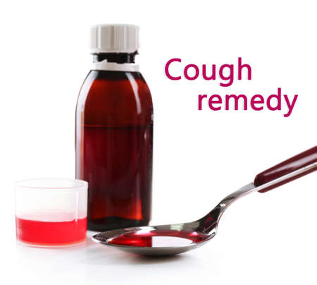 Cough syrup isolated on white photo