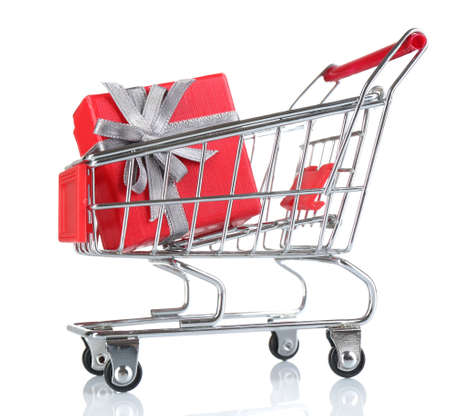Small shopping cart with present box isolated on white photo