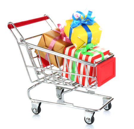 christmas budget: Small shopping cart full of gifts, isolated on white