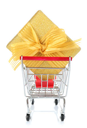 christmas budget: Small shopping cart with present box isolated on white